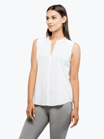 Women's White Juno Sleeveless Blouse on Model Facing Left