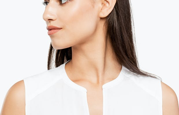 Women's White Juno Sleeveless Blouse on Model Facing Left in Close-Up of Neckline