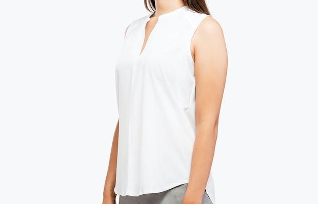 Women's White Juno Sleeveless Blouse on Model Facing Left