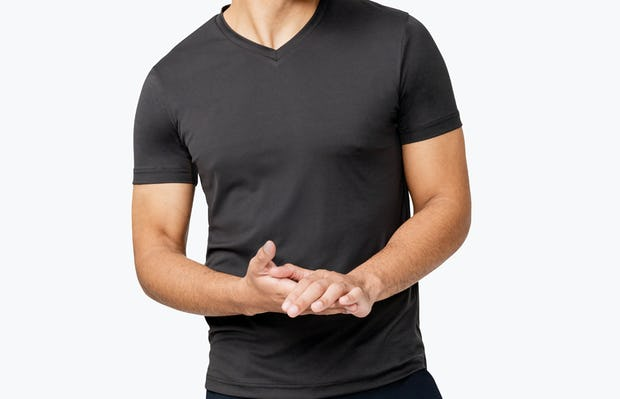 Men's Black Responsive V-Neck Tee model facing forward with hands clasped
