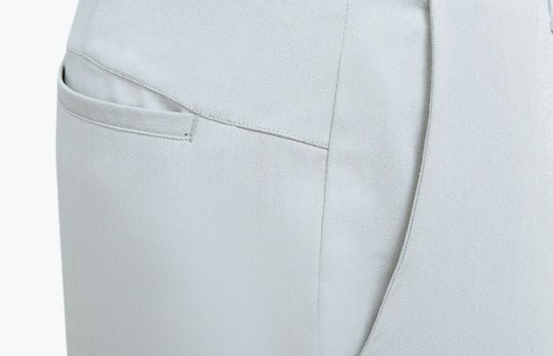 Men's Stone Momentum Chino on Model Facing Left in Close-Up of Side Pocket