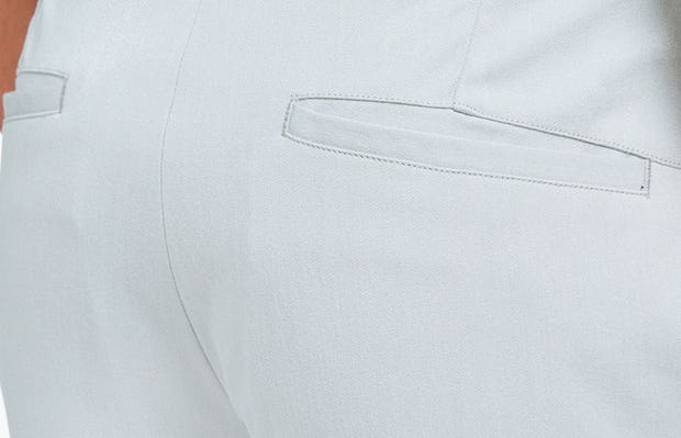 Men's Stone Momentum Chino on Model Facing Backward in Close-Up of Back Pocket