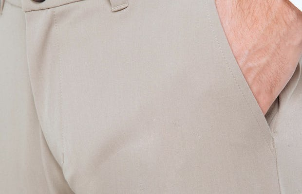 Men's Khaki Momentum Chino on Model Facing Right in Close-Up of Hand in Pocket
