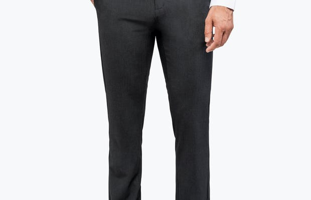 Men's Dark Charcoal Velocity Dress Pant on Model Facing Forward with Hand in Pocket