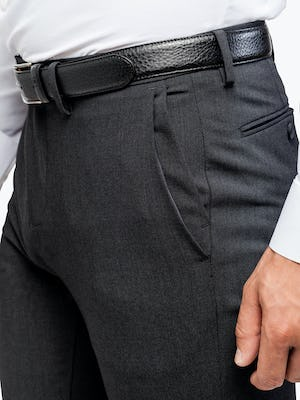 Men's Dark Charcoal Velocity Dress Pant on Model in Close-Up of Front Pockets