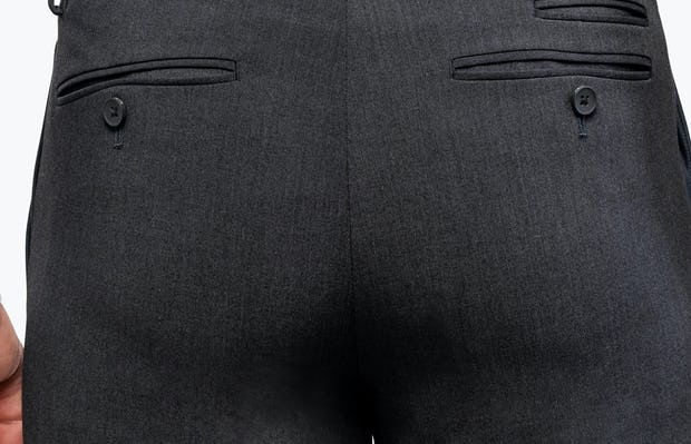 Men's Dark Charcoal Velocity Dress Pant on Model in Close-Up of Back Pockets