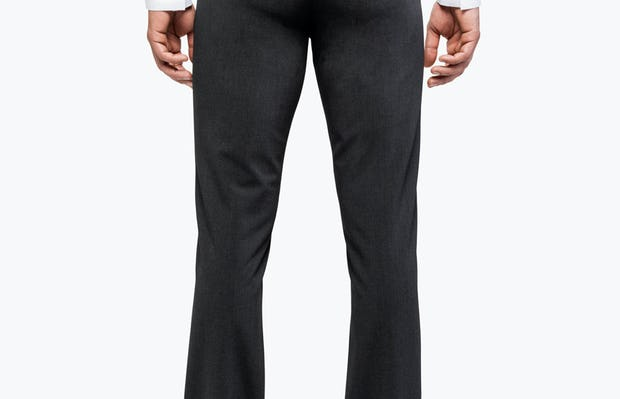 Men's Dark Charcoal Velocity Dress Pant on Model Facing Backward