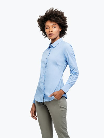 Women's Solid Blue Nylon Aero Dress Shirt on Model with Hand in Her Pocket
