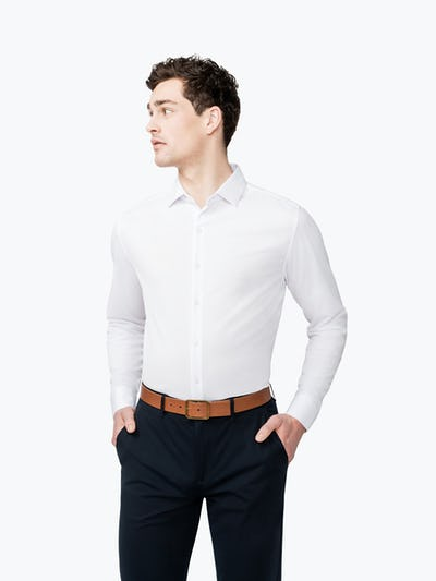 Men's White Brushed Apollo dress shirt model facing forward and to the left with hands in pockets