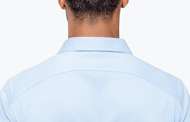 Men's Light Blue Brushed Apollo Dress Shirt on Model Facing Backward in Close-Up of Curved Back Yolk and Collar