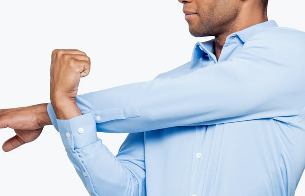 Men's Light Blue Brushed Apollo Dress Shirt on Model Facing Forward Stretching Arm In Front of Chest