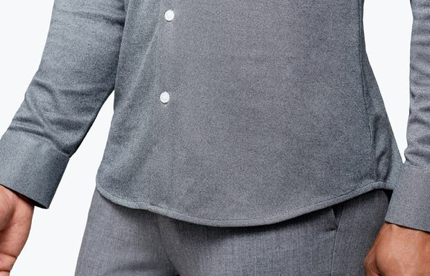 Men's Charcoal Oxford Brushed Apollo Dress Shirt on Model Facing Right in Close-Up of Bottom Hem Line