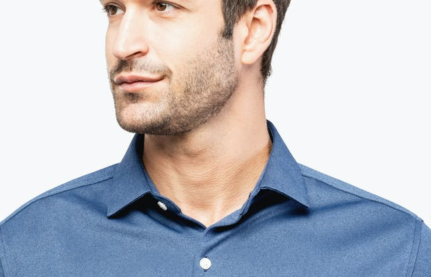 Men's Navy Oxford Brushed Apollo Dress Shirt on Model Facing Forward in Close-Up of Unbuttoned Collar
