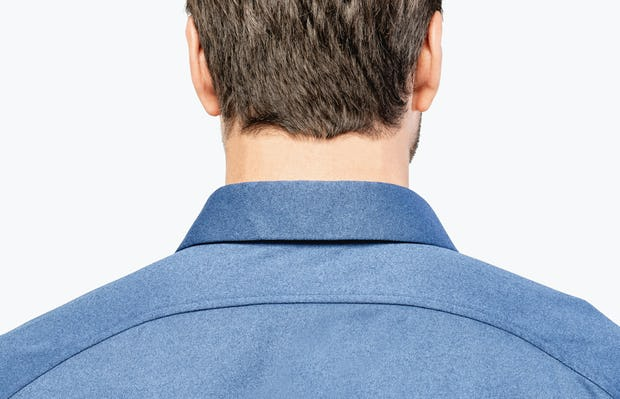 Men's Navy Oxford Brushed Apollo Dress Shirt on Model Facing Backward in Close-Up of Curved Back Yolk and Collar