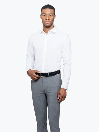 Men's White Apollo Dress Shirt model facing forward and to the left with hand on belt