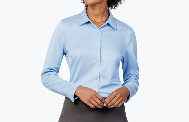 Women's Light Blue Apollo Tailored Shirt on Model with Hands in Front of Her