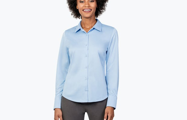 Women's Solid Blue Nylon Aero Dress Shirt on Model Facing Forward and Smiling