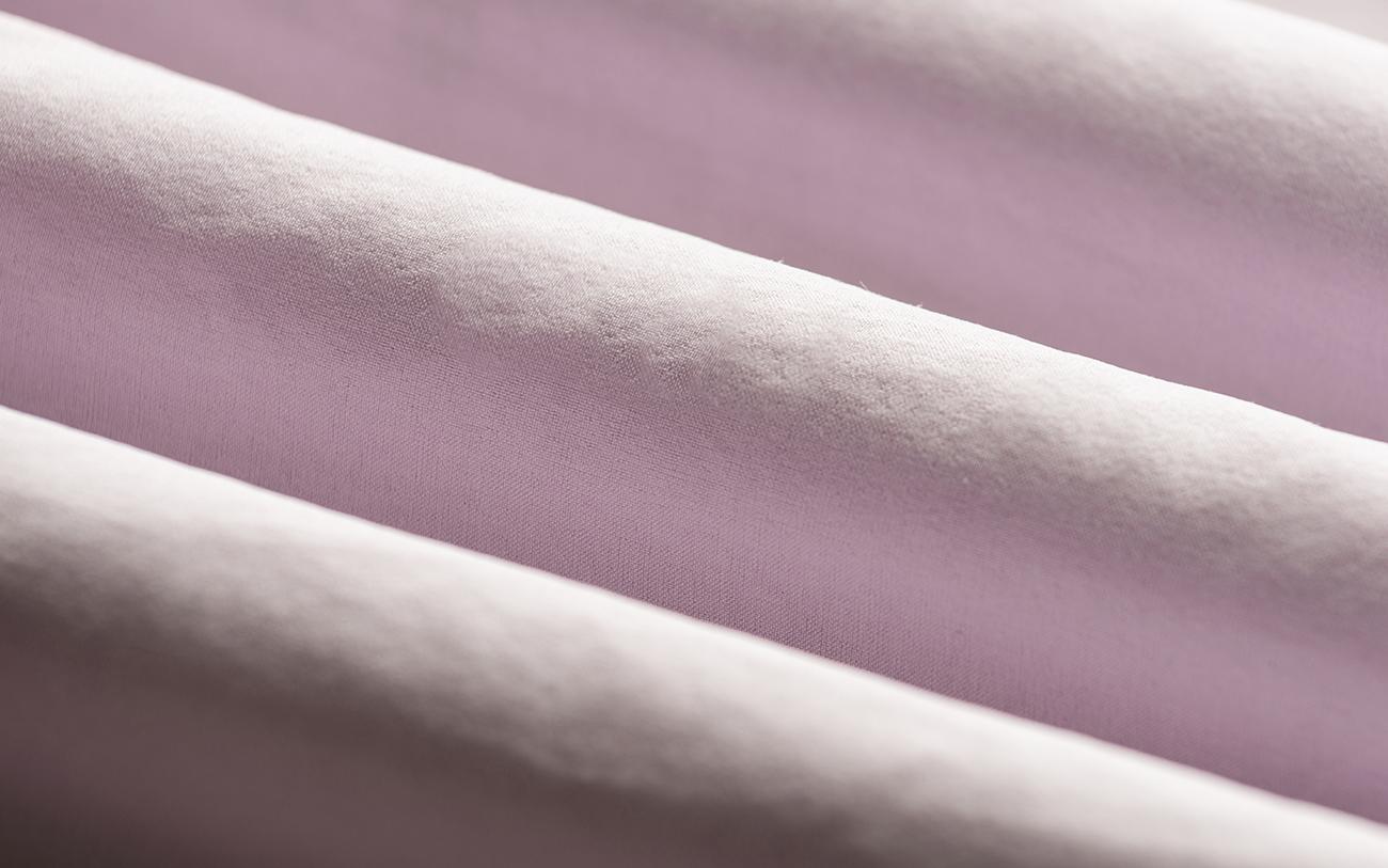 Close-up of Light Pink Fabric Rolls