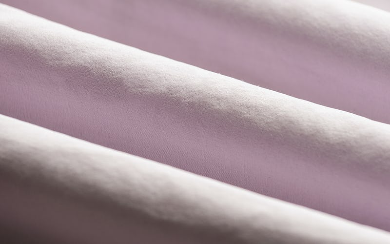 Close-up of Light Pink Fabric Rolls
