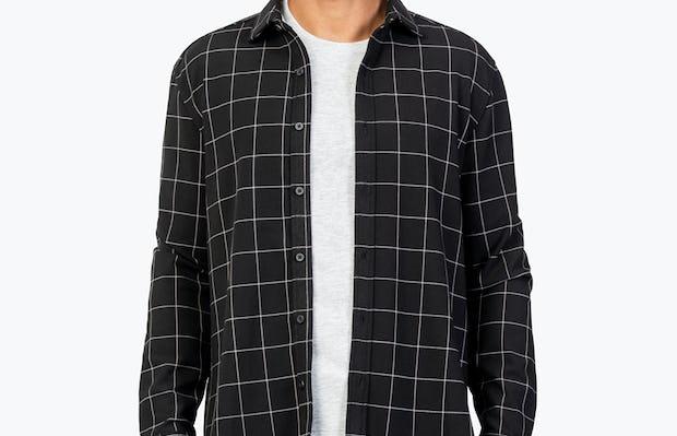 Men's Black Fusion Overshirt model facing forward with shirt unbuttoned