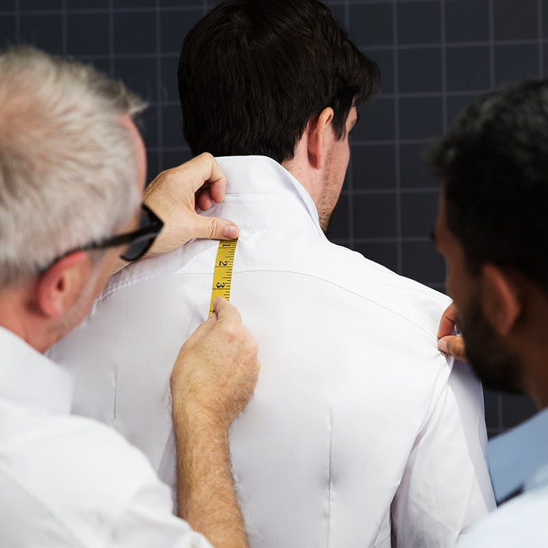 Man measuring a shirt to fit