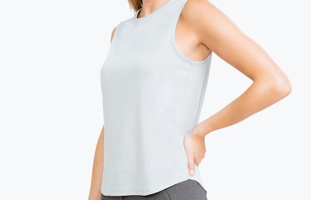 Women's Grey Composite Merino Tank on Model with Hand on Her Back