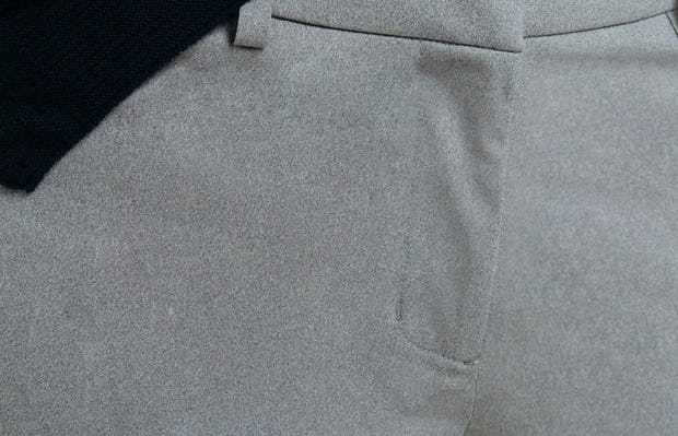 Women's Grey Heather Kinetic Slim Pants on Model in Close-Up of Front Fly Closure