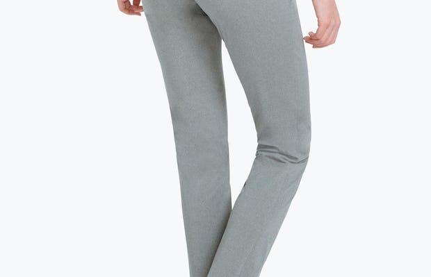 Women's Grey Heather Kinetic Slim Pants on Model Walking Backward