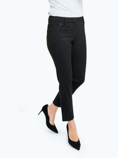 Women's Black Velocity Classic Crop Pant on Model Walking to Her Left