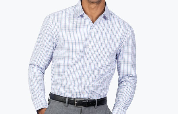 Men's Lavender Tattersall Aero Zero Dress shirt model facing forward with hands in pockets