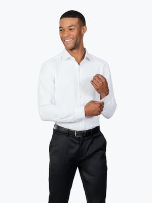Men's White Aero Zero Dress shirt model facing forward adjusting left cuff