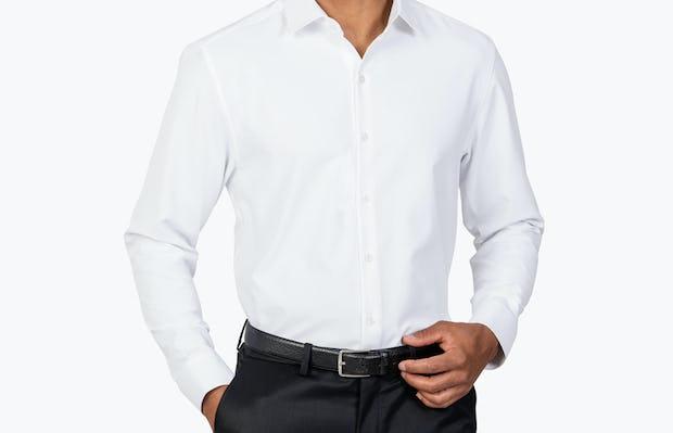 Men's White Aero Zero Dress shirt model facing forward with hand in pocket