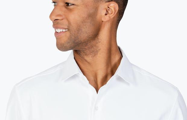 Men's White Aero Zero Dress shirt headshot of model looking to the right