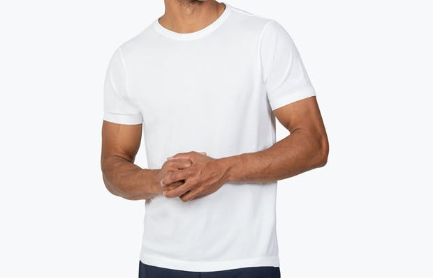 Men's White Atlas Crew Neck Tee model with hands clasped