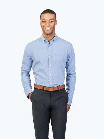Men's Blue Grid Gemini shirt model facing forward with right hand in pocket