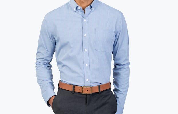 Men's Blue Grid Gemini shirt model facing forward with right hand in pocket