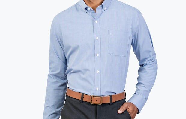 Men's Blue Grid Gemini shirt model facing forward with left hand in pocket