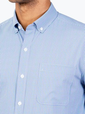 Men's Blue Grid Gemini Woven shirt model facing forward and to the right with closeup of placket