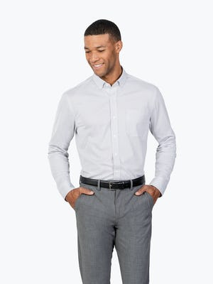 Men's Grey Stripe Gemini Knit shirt model facing forward with hands in pockets