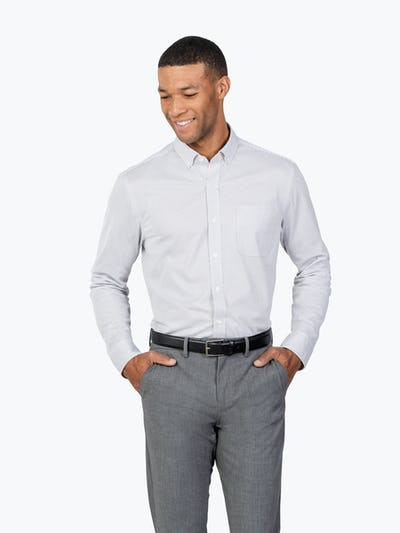 Men's Grey Stripe Gemini Knit shirt model facing forward with hands in pockets