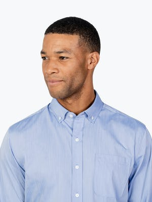 Men's Blue Gemini Woven shirt headshot of model looking to the right