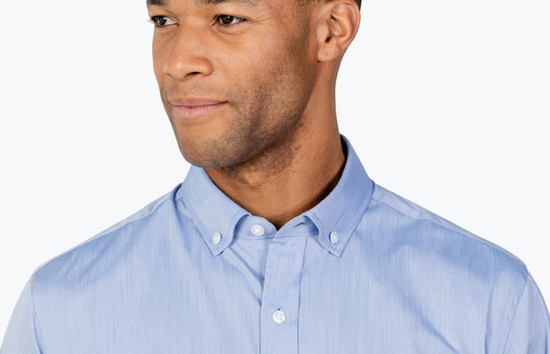Men's Blue Gemini shirt headshot of model looking to the right