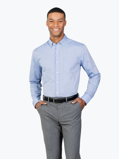 Men's Blue Gemini shirt model facing forward and to the right hands in pockets