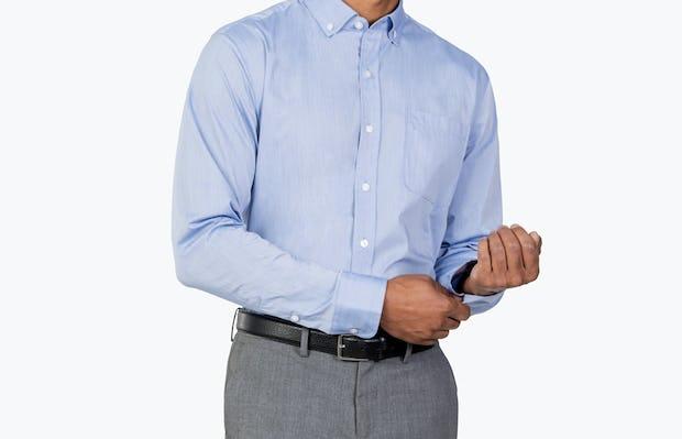 Men's Blue Gemini shirt model facing forward fixing cuff