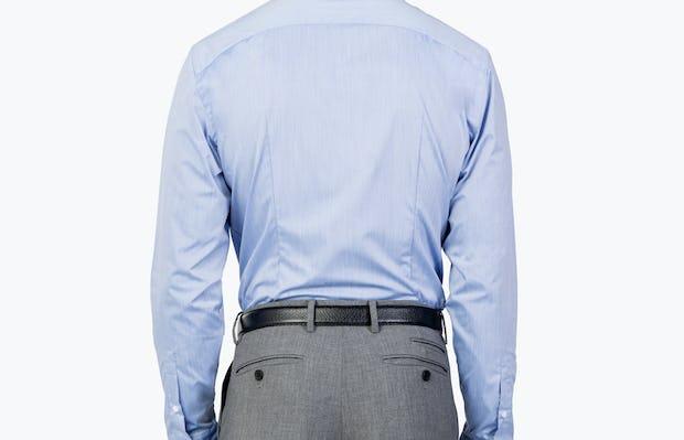 Men's Blue Gemini shirt model facing backward