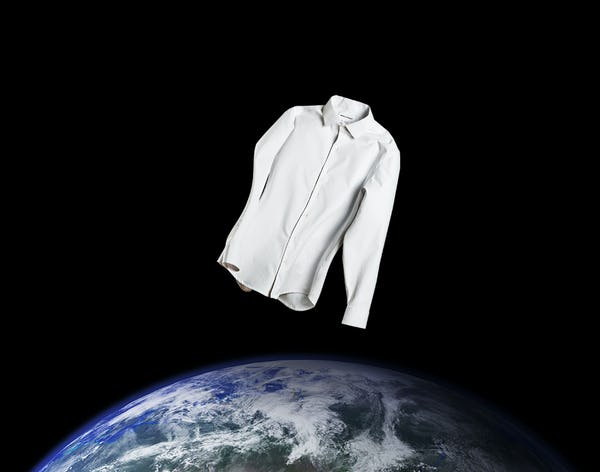 White Aero Zero Dress Shirt Floating Over the Earth