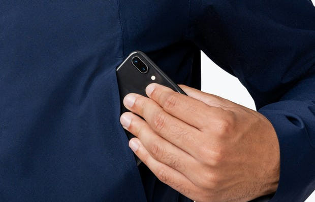 Men's Navy Dry Days Mac on Model in Close-Up of Removing Phone from Pocket