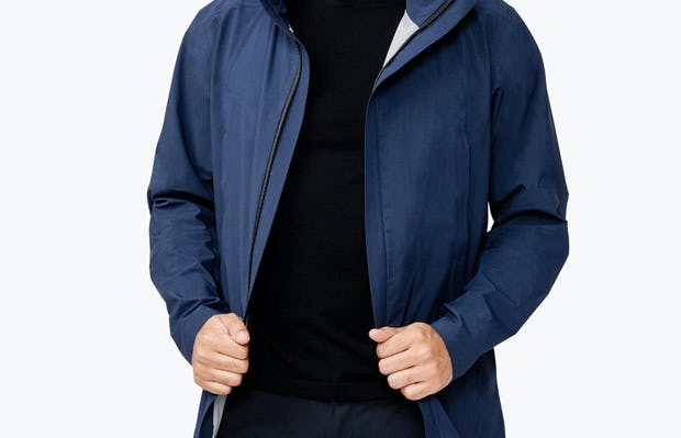Men's Navy Dry Days Mac on Model Facing Forward Unzipped Adjusting Jacket Sides