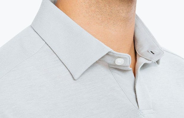 Men's Grey Composite Polo on Model in Close-Up of Collar Unbuttoned