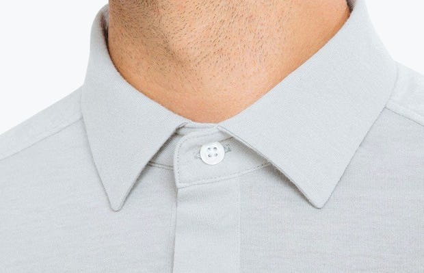 Men's Grey Composite Polo on Model in Close-Up of Collar Buttoned Up